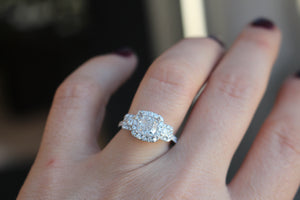 white and rose gold three stone engagement ring for cushion cut diamond center