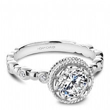 white gold bezel set round diamond engagement ring with channel set shank
