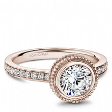 rose gold bezel set engagement ring for a round diamond