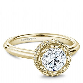 yellow gold diamond solitaire engagement ring with decorative head