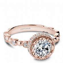 rose gold diamond engagement ring with a decorative head