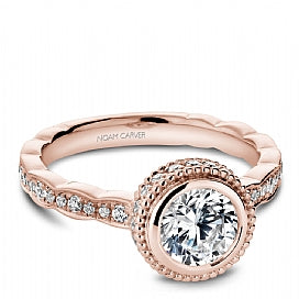 rose gold bezel set halo engagement ring for a round diamond