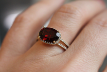 4 Carat Oval Cut Diamond and Garnet Halo Ring in 14kt Yellow Gold