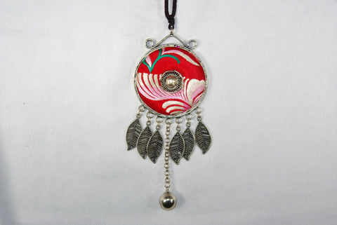 Large pendant - circular with scrolls and leaves