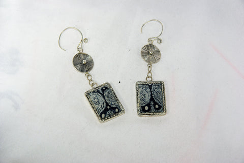 Rectangular small earrings with tribal charm reversed