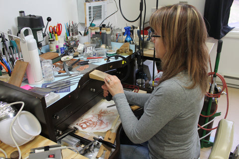 Tracy Hibsman making jewelry that touches the soul.  In the studio at the bench.