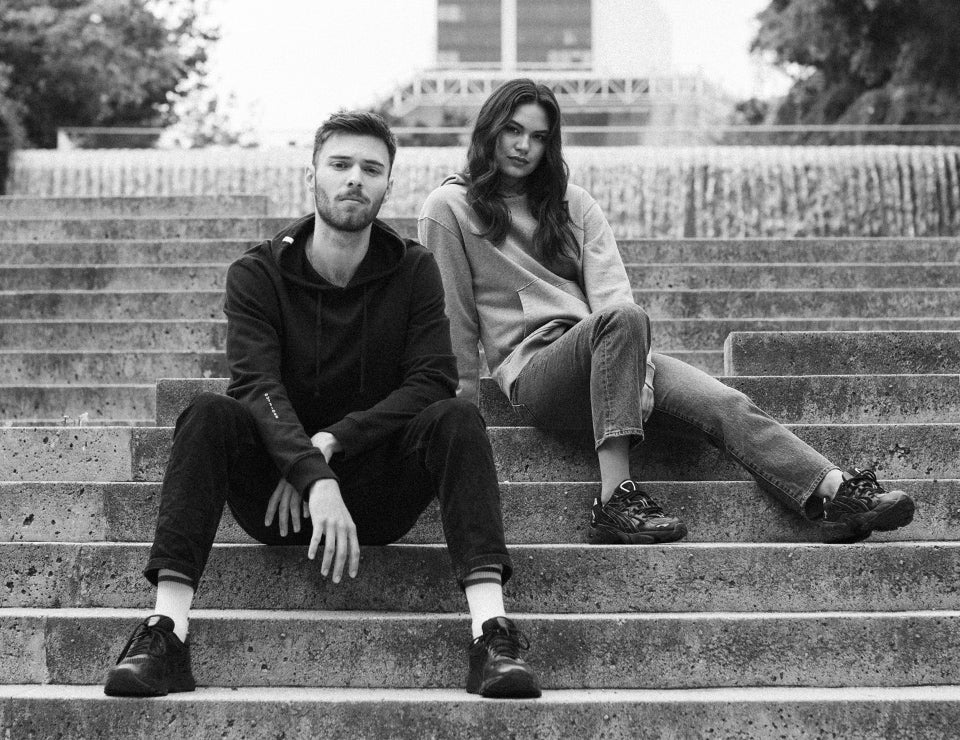 A man and woman modeling on steps.
