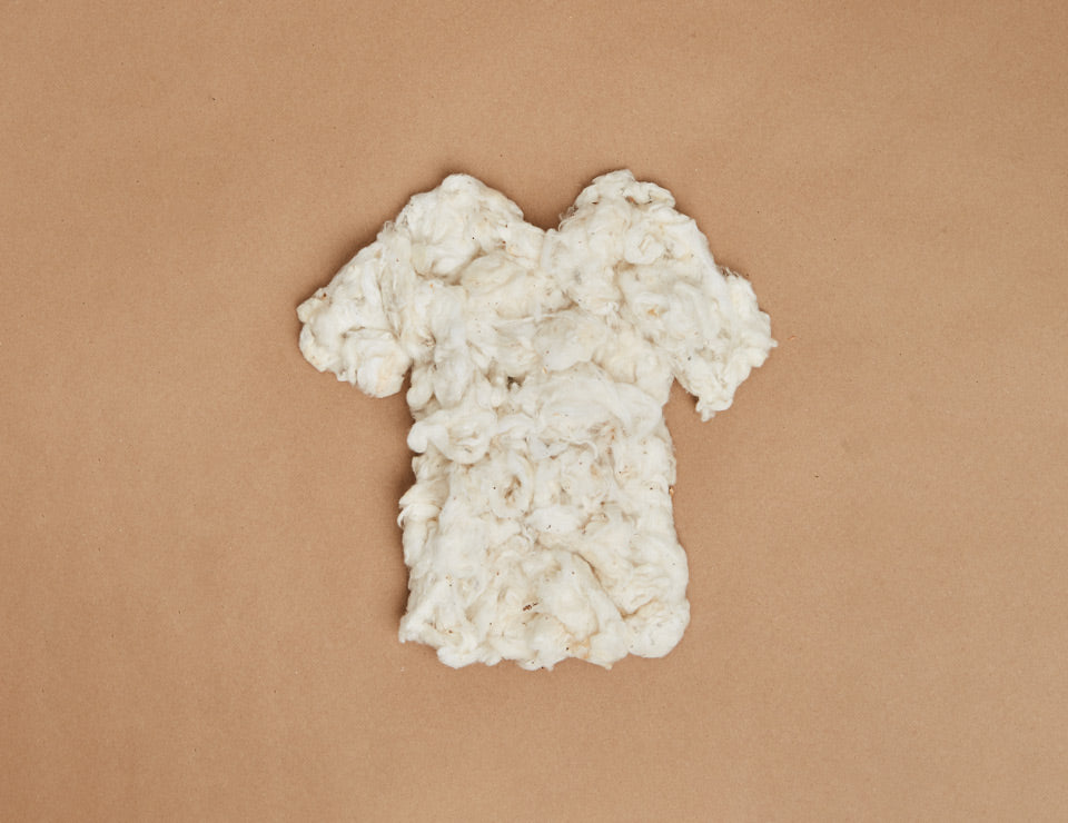 A silhouette of a t-shirt made with organic cotton.