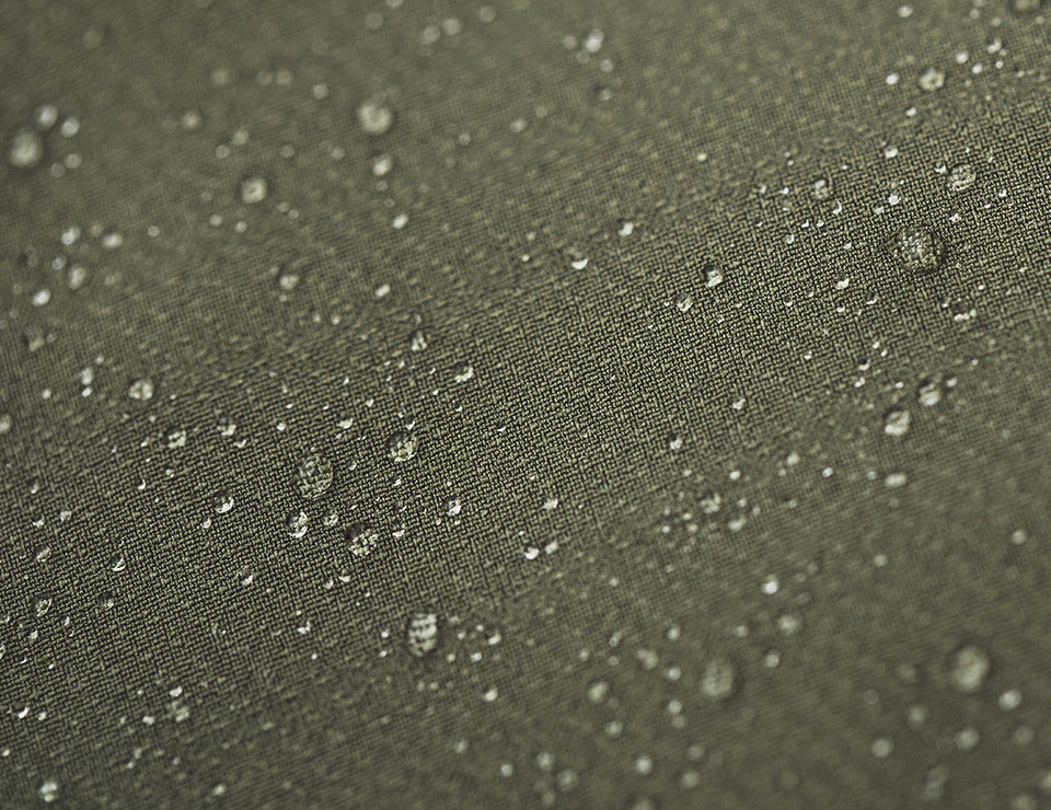 An up-close shot of the pants showing the water beading off of the pant material.