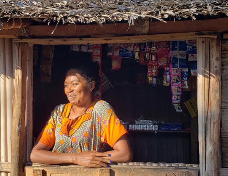 An image of Mama Nata, a local merchant and tree-planter in Mahabana.