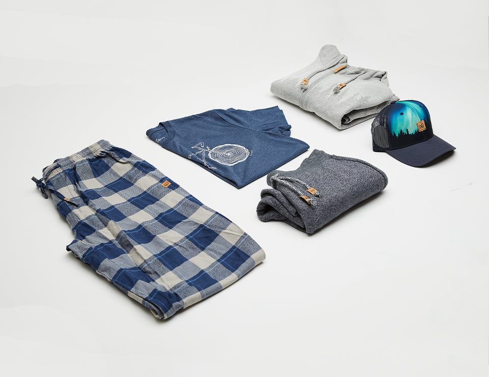 Various mens items that could come in a single mystery bag. Example: Pyjama pants, a t-shirt, sweat pants, a sweater and a hat.