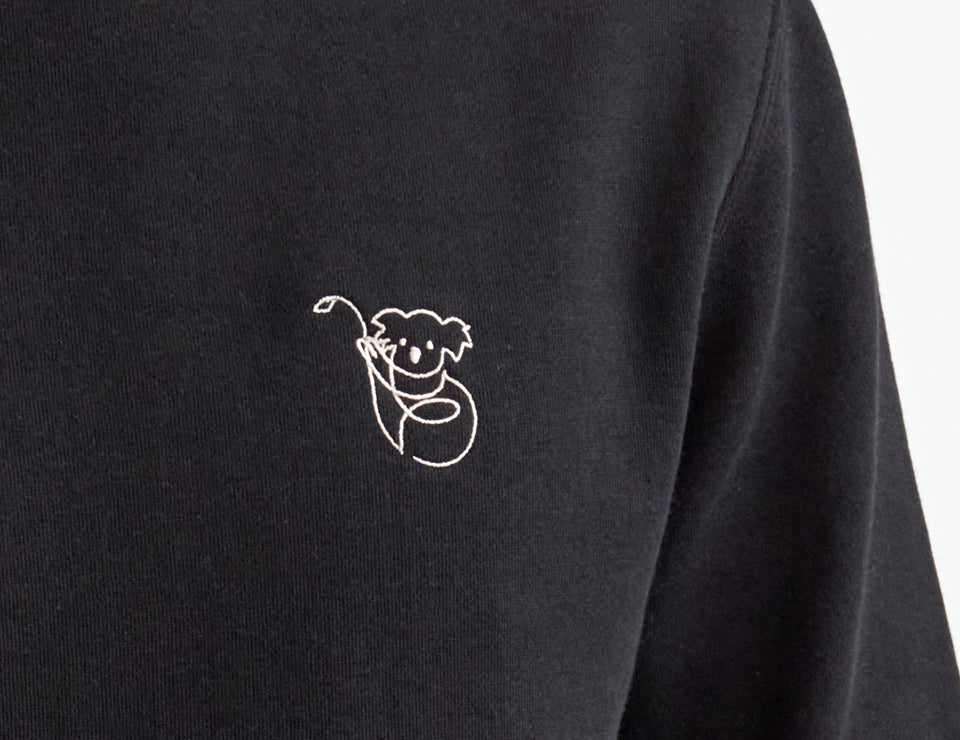 A black shirt with a small koala logo.