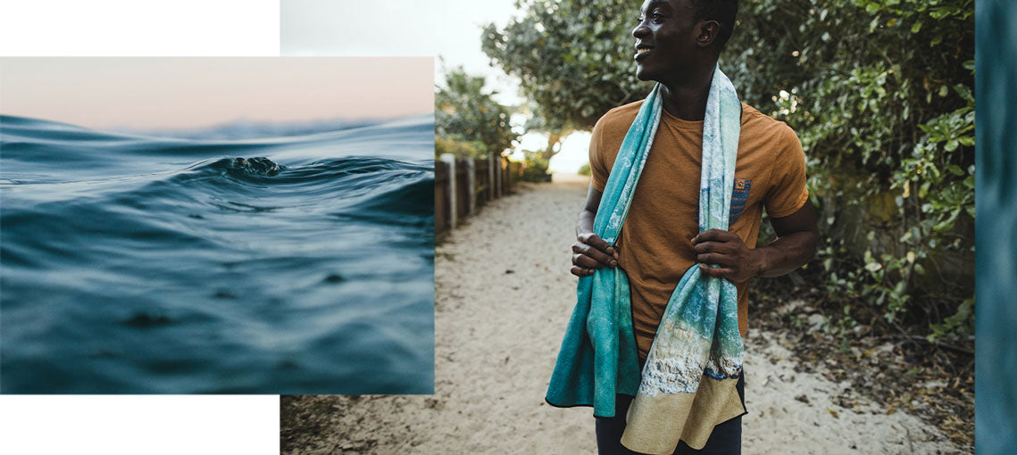 Man with blue shoreline beach towel around his neck