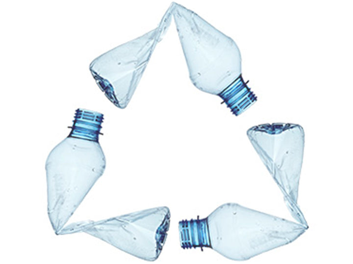 A recycling symbol made from bend plastic water bottles.