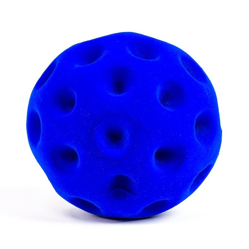 Rubbabu Golf Ball with indentations that resemble a real golf ball for sensory exploration.