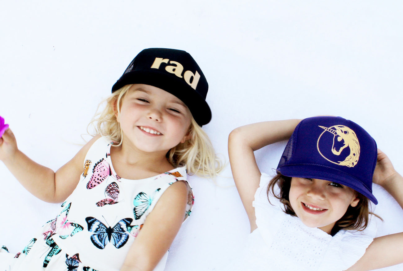 rad, cool kids clothing, unicorn present, unicorn gift guide, butterfly dress, kids trucker hats, mothersun and the captain
