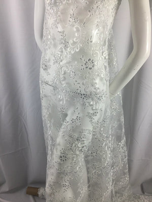 Master design embroidered mesh lace fabric white. Sold by the yard - KINGDOM OF FABRICS