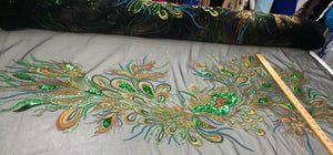Emerald green peacock feathers on a black mesh lace embroider.45x50 inches.sold by panels. - KINGDOM OF FABRICS