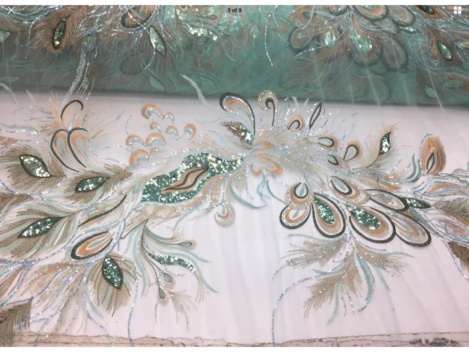 Peacock Feathers Embroider With Sequins And Metallic Tread On a Mint Mesh Lace. - KINGDOM OF FABRICS