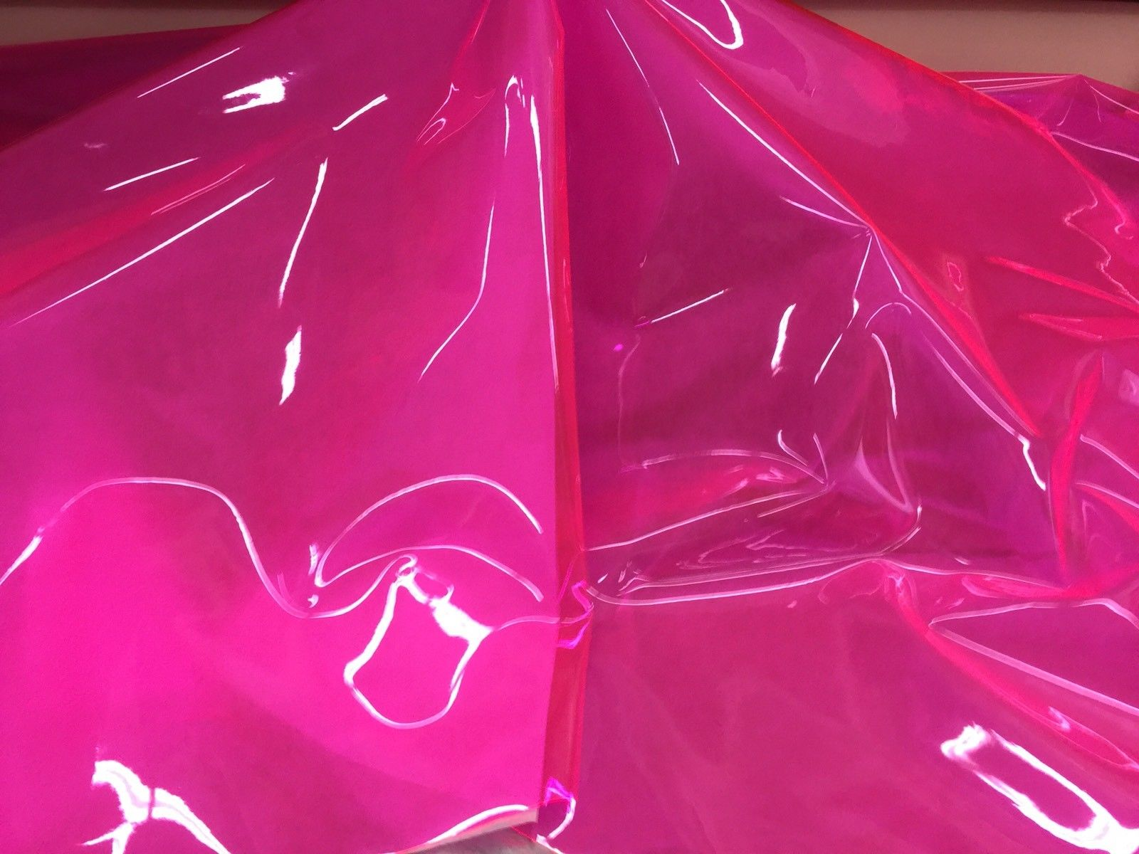 Plastic Tinted Vinyl Fuchsia 12 Gauge 54 Inch Wide Fabric sold By the Yard - KINGDOM OF FABRICS