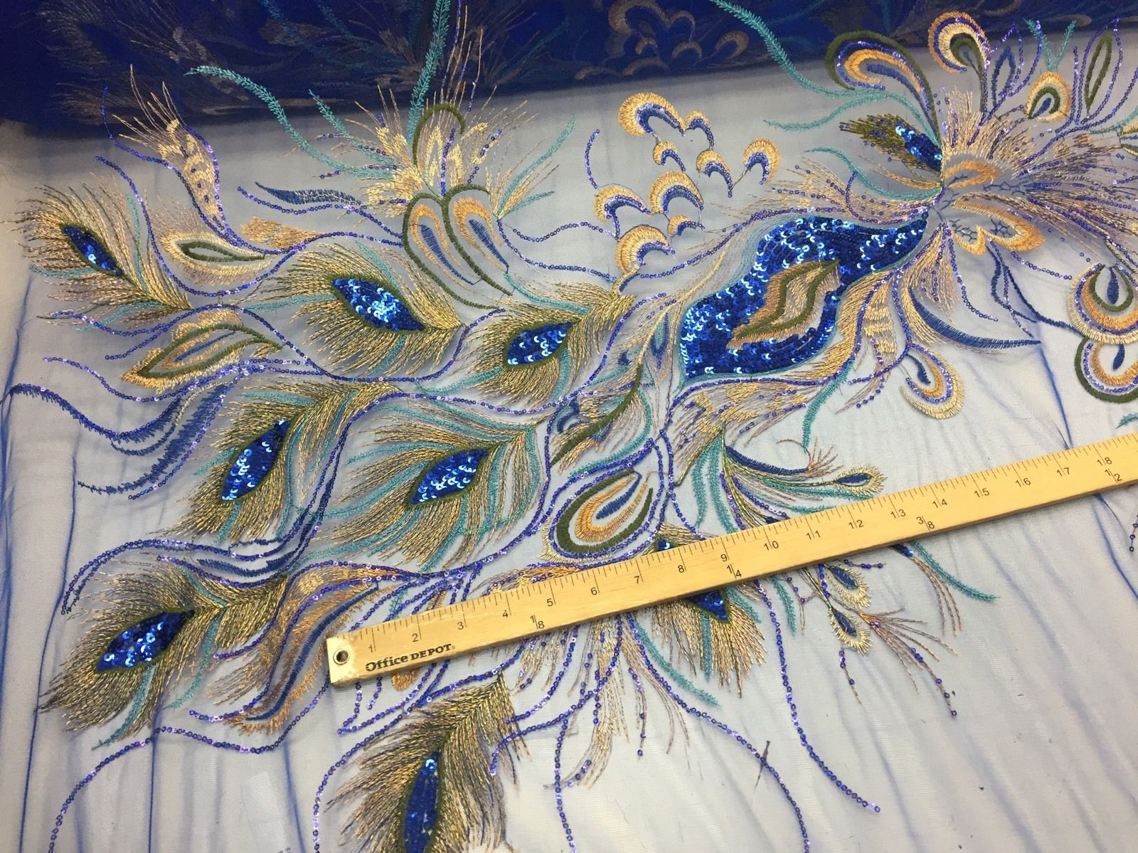 Peacock Feathers Embroider With Sequins And Metallic Tread On A Royal Blue Mesh. - KINGDOM OF FABRICS