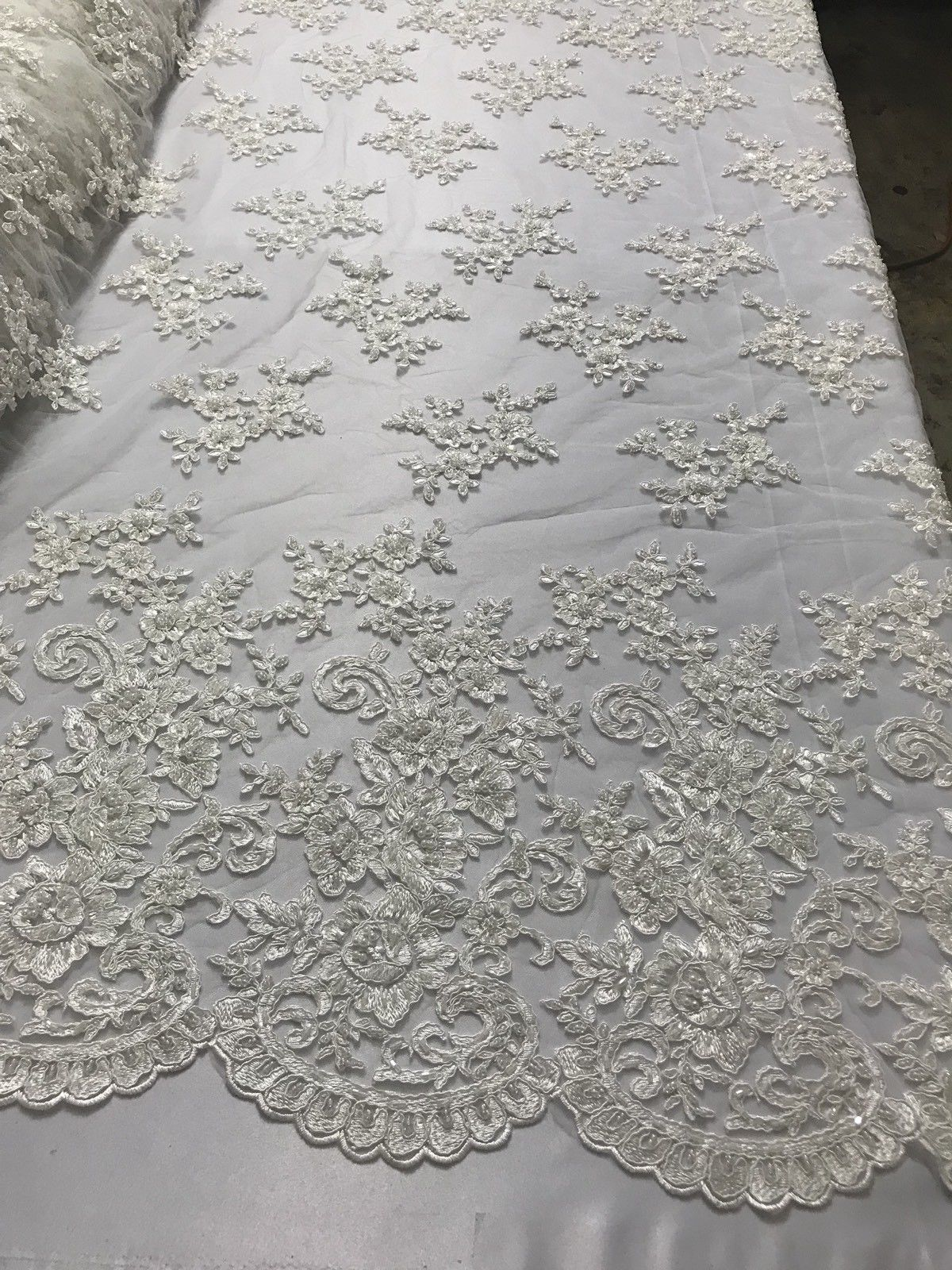 IVORY ROSE FASHION FLORAL DESIGN EMBROIDER WITH SEQUINS AND BEADS ON A MESH-YARD - KINGDOM OF FABRICS