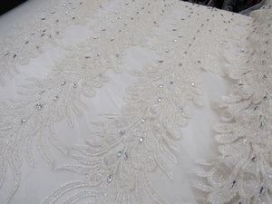 Supreme bridal wedding peacock beaded feather meshlace ivory. Sold by 2 feather. - KINGDOM OF FABRICS