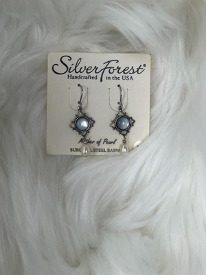 Silver earrings with light blue stone