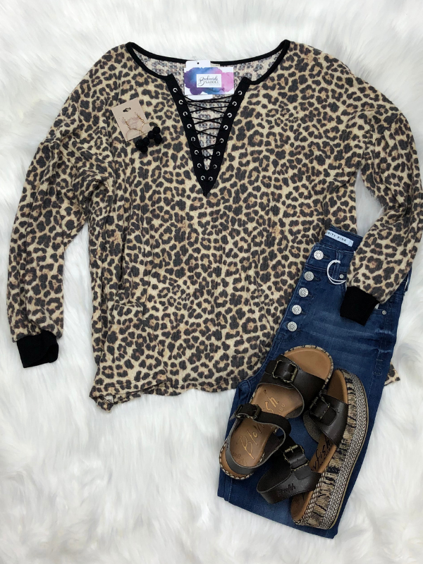 Lace-up V-neck animal print top