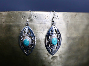 Sterling Silver and turquoise Tibetan earring closeup photo