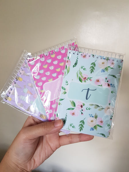 Package of 10 monogram notebooks