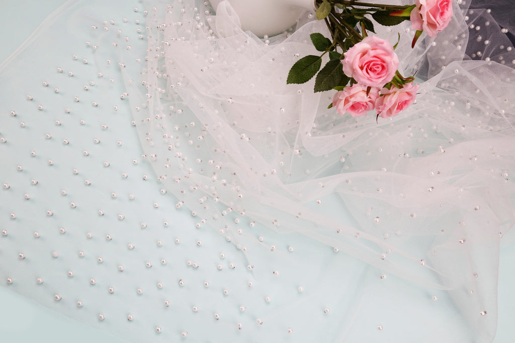 Beaded mesh fabric for occasional wear