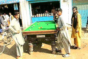 Australian Cricket Tours - Boys Playing Snooker On A Road-side Snooker Table In Multan, Pakistan