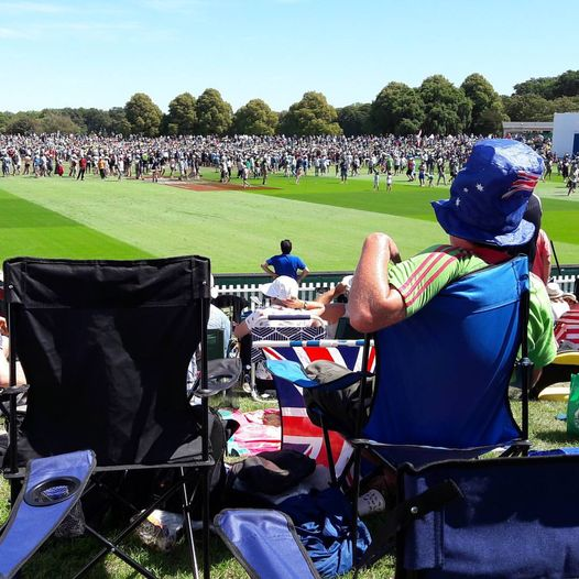 Australian Cricket Tours - Jim Sydo Relaxes At The Lunch Break Watching Thousands Of People Enjoy Time On The Field At The Lunch Break At Hagley Park, Christchurch, During Australia Vs Zealand 2nd Test In 2016