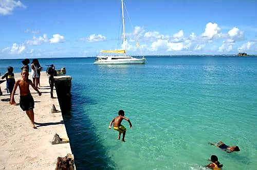 Australian Cricket Tours - A Young West Indian Lad Jumping Into The Turquoise Waters Of St Martin