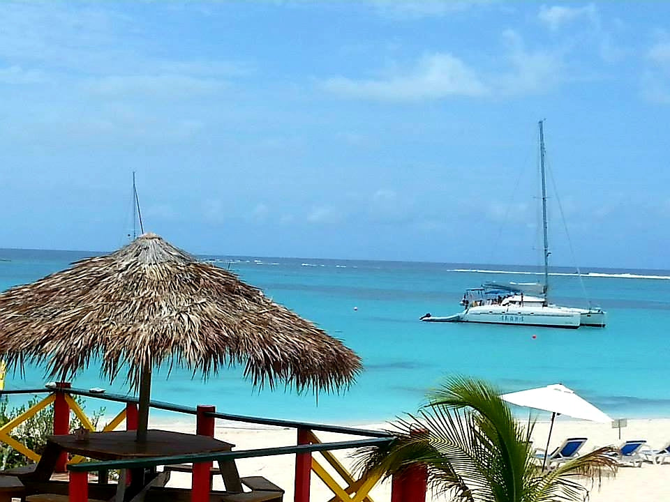 Australian Cricket Tours - Our Beautiful Catamaran Sits In The Distance On The Turquoise Waters Of Prickly Pear, Anguilla