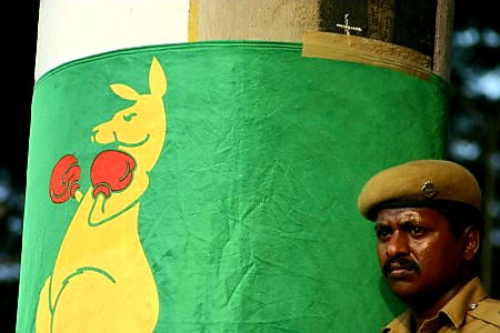 Australian Cricket Tours - An Indian Police Officer Leans Against The Boxing Kangaroo Flag Wrapped Around A Pillar In Chepauk Stadium, Chennai, India