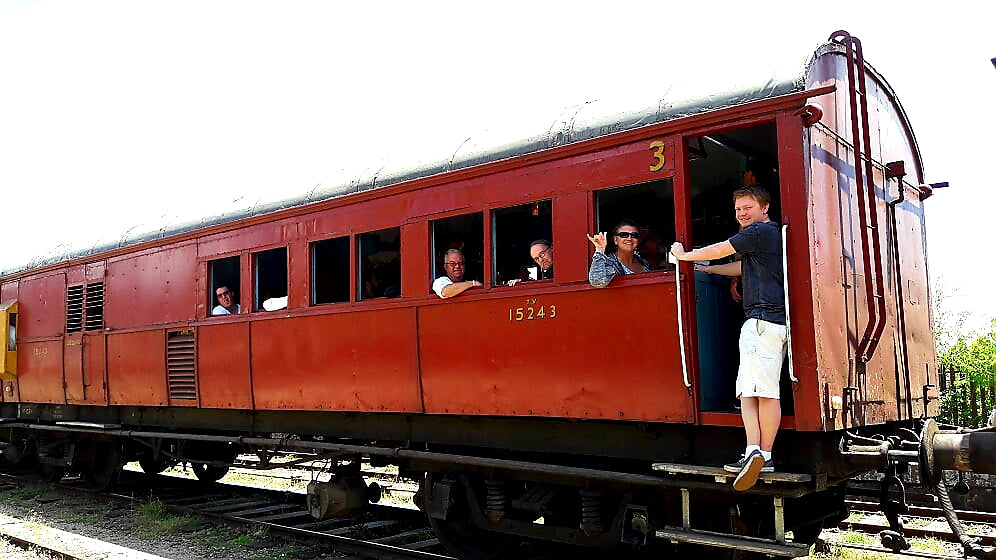 Australian Cricket Tours - Happy Clients Waving From The Train From Nanyoya To Ella, As It Sits In A Station, Sri Lanka