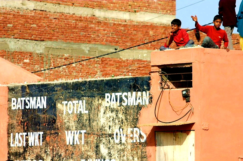 Australian Cricket Tours - Two Boys Sit Atop An Ageing Brick Wall Cricket Scoreboard In Jaipur
