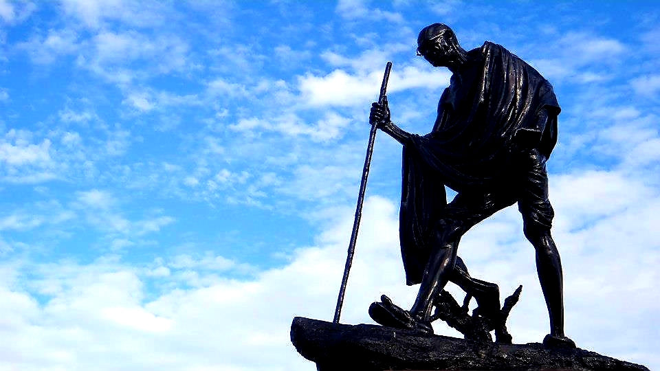 Australian Cricket Tours - Statue Of Mahatma Gandhi Silhouetted Against A Blue Sky