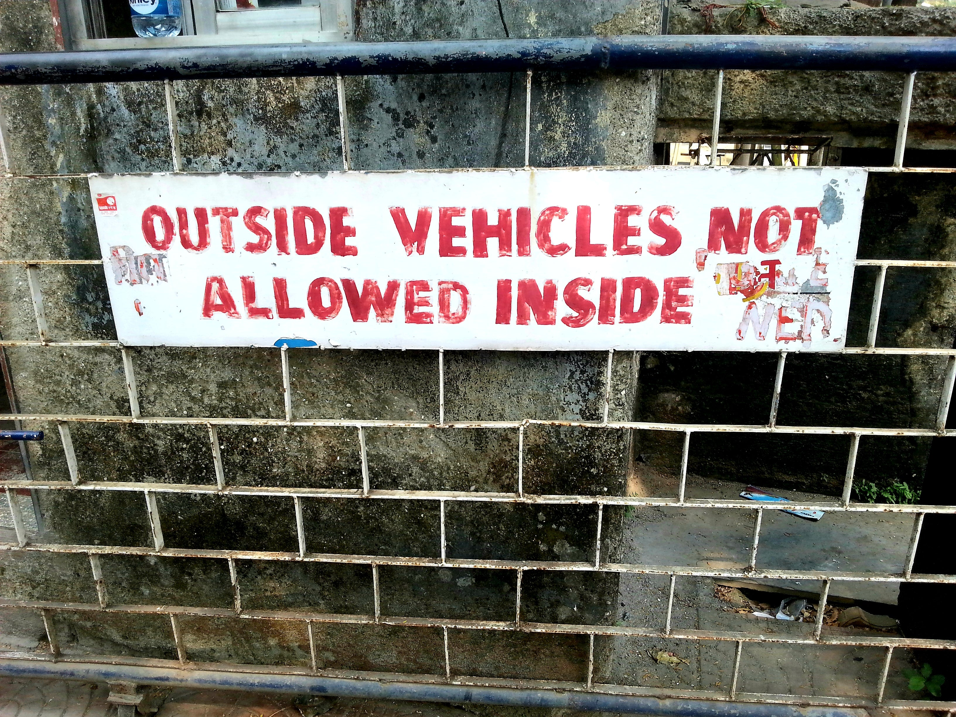 Australian Cricket Tours - An Unique Sign In India On A Gate That Reads 'Outside Vehicles Not Allowed Inside'!