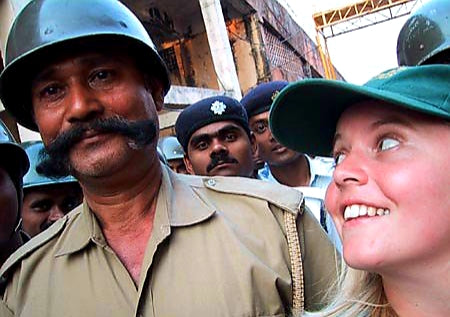 Australian Cricket Tours - Cassandra Hewett Smiles Broadly At A Police Officer Outside Eden Gardens, Kolkata During The 2nd Test Match Between Australia vs India 2001