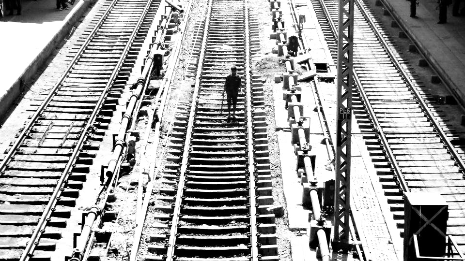 Australian Cricket Tours - A Lone Man Walks Down The Tracks At New Delhi Railway Station As Seen From The Footbridge Over The Station