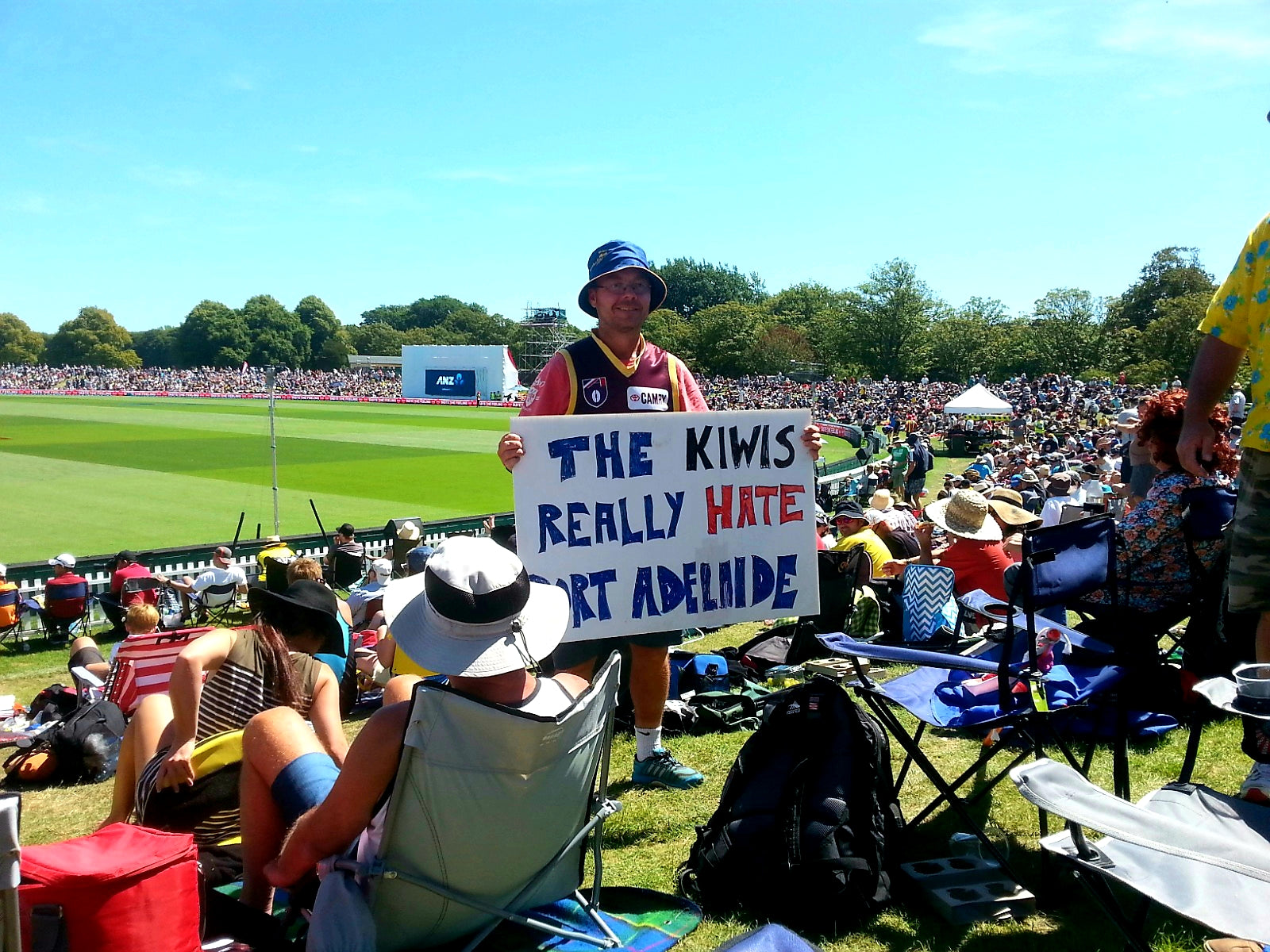 Australian Cricket Tours - An Australian Adelaide Crows Spectator Holding A Sign That Reads 'The Kiwis Really Hate Port Adelaide' At Hagley Oval, Christchurch New Zealand