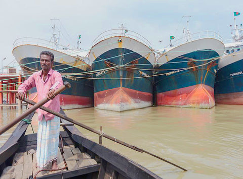 A Fisherman Ready To Negotiate The Tankers In The Karnaphuli River, Chattogram, Bangladesh
