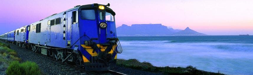 Australian Cricket Tours - Getting T & Through South Africa, The Blue Train Leaving Cape Town At Dusk, With Table Mountain In The Background