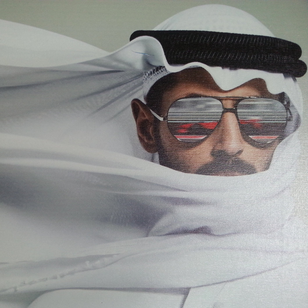 A Ferrari In The Reflection Of A Sheikh's Sunglasses