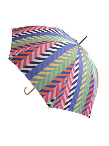 Luxury slim umbrella with bright chevron print, elegant black frame and striking gold handle by David David, a fashion accessories brand and print studio based in London England, specialising in bold geometric print
