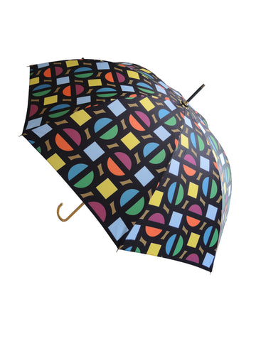 Luxury slim umbrella with bright roundel print, elegant black frame and striking gold handle by David David, a fashion accessories brand and print studio based in London England, specialising in bold geometric print