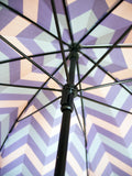 Luxury slim umbrella with jewel chevron canopy design, elegant black frame and striking gold handle by David David, a fashion accessories brand and print studio based in London England, specialising in bold geometric print